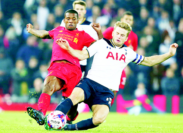 Tottenham Hotspur's Eric Dier (right), tackles Liverpool's Georginio Wijnaldum during the English League Cup soccer match between Liverpool and Tottenham Hotspur at Anfield in Liverpool, England on Oct 25. (AP)