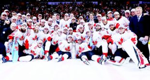 Team Canada pose for a team photo following their 2-1 victory against Europe in Game Two of the World Cup of Hockey final series at the Air Canada Centre on Sept 29, in Toronto, Canada. Canada defeated Europe 2-1 to win the World Cup. (AFP)