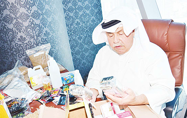 Head of the General Directorate for Drug Control Lieutenant General Suleiman Al-Fahad inspects the seized contraband.