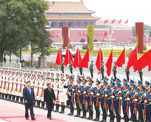 Philippines President Rodrigo Duterte (center), and Chinese President Xi Jinping review the guard of honors as they attend a welcoming ceremony at the Great Hall of the People in Beijing on Oct 20