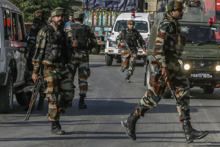 Indian army soldiers arrive outside the base camp which was attacked by suspected militants at Baramulla, northwest of Srinagar, Indian controlled Kashmir, Monday, Oct. 3, 2016. A gun battle with a group of militants who attacked an Indian army camp in the Indian portion of Kashmir has ended early Monday morning, police said. (AP Photo/Mukhtar Khan)