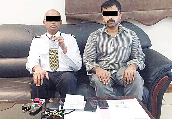 The suspect with one of his alleged clients