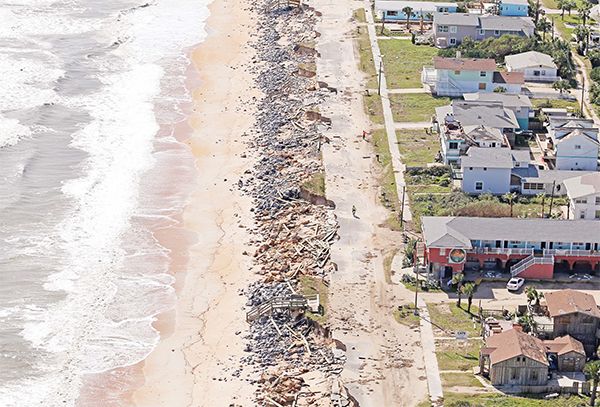 Debris lies on a portion of the damaged A1A Highway which was closed in Flagler Beach, Fla on Oct 8, after pounding surf from Hurricane Matthew which brushed Florida's east coast