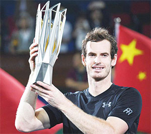 Andy Murray of Britain holds his trophy after winning his men's singles fi nals match against Roberto Bautista Agut of Spain at the Shanghai Masters tennis tournament in Shanghai on Oct 16. (AFP)