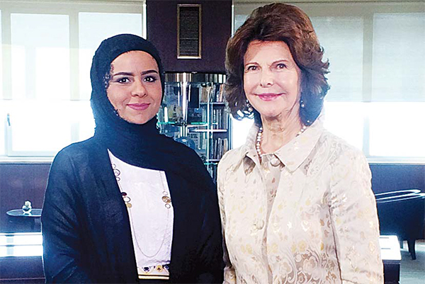 Queen Silvia of Sweden chairperson of Mentor Foundation International with a KUNA jounalist.