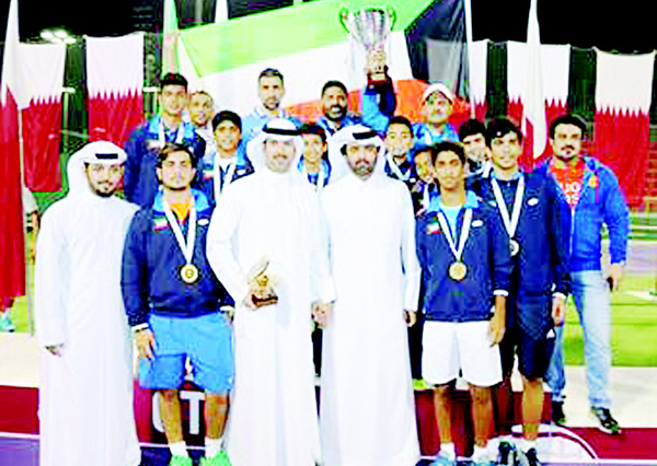 Kuwait's national tennis team pose with their trophy after winning the 2016 GCC Junior Tennis Championship in Qatar.