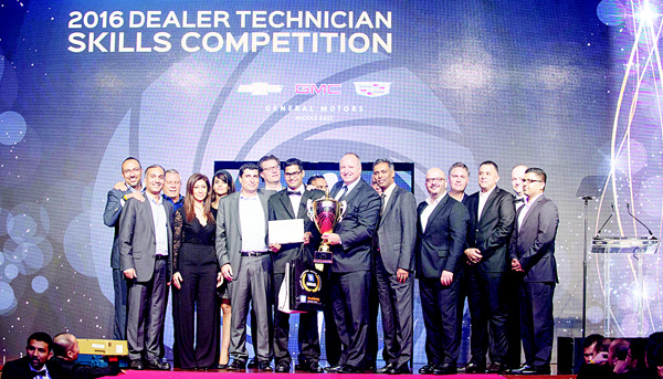 The winner receiving the top prize award after finishing first in the GM dealers technician competition.