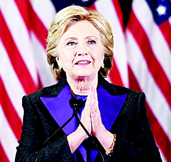 US Democratic presidential candidate Hillary Clinton makes a concession speech after being defeated by Republican presidential-elect Donald Trump, in New York on Nov 9. (AFP)