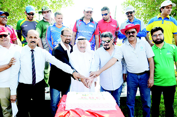 Officials cut the ceremonial cake to declare the Kuwait Banks Club Cricket League open