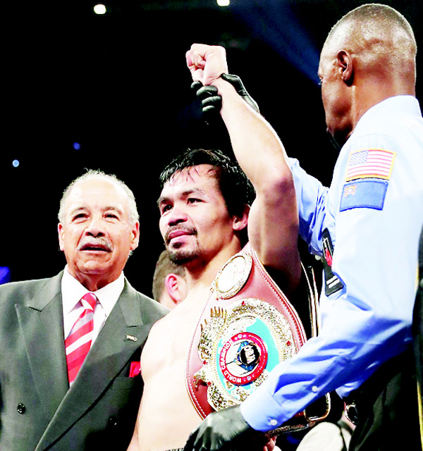 Manny Pacquiao of the Philippines celebrates after his unanimous-decision victory over Jessie Vargas at the Thomas & Mack Center on Nov 5, in Las Vegas, Nevada. Pacquiao won the WBO welterweight championship. (AFP)