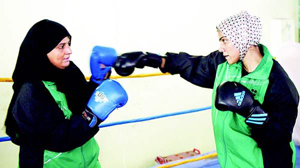 In this photograph taken on Oct 6, 19-year-old Pakistani boxer Razia Banu (right), throws a punch at her mother Haleema Addul Aziz during a practice session at the Pak Shaheen Boxing Club in Karachi. (AFP)