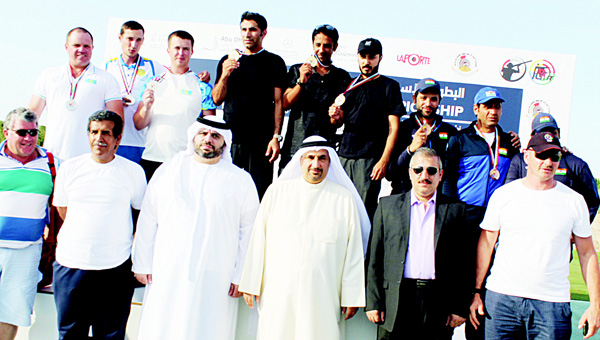 Kuwaiti shooters Saud Habib, Nasser Al-Daihani and Zaid Al-Mutairi display their gold medals with other medalists on the podium after the awarding ceremony in the 6th Asian Shooting Championship in Abu Dhabi.