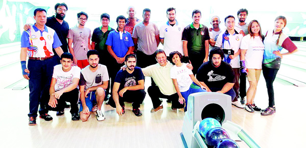 Participants pose for a group photo during the Q8 Bowling First Single Challenge.