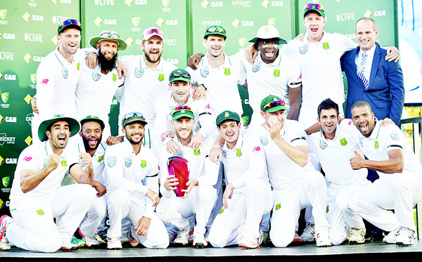The South Africa cricket team poses for photos with the trophy after beating Australia in the series at the end of the game on the fourth day of the third Test cricket match between Australia and South Africa at the Adelaide Oval in Adelaide on Nov 27. (AFP)