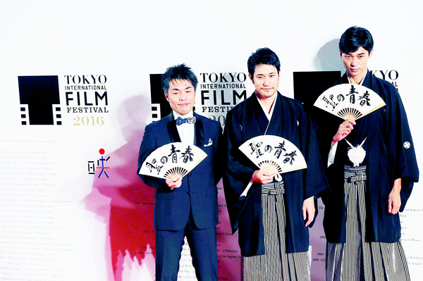In this Oct 25, 2016 photo, film director Yoshitaka Mori (left), Japanese actors Kenichi Matsuyama (center), and Masahiro Higashide pose for photographers on the red carpet during the Tokyo International Film Festival opening ceremony in Tokyo. (AP)