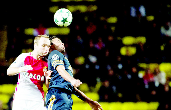 Tottenham Hotspur's Belgian midfielder Moussa Dembele (right), vies with Monaco's French forward Valere Germain during the UEFA Champions League Group E football match AS Monaco and Tottenham Hotspur FC at the Louis II Stadium in Monaco on Nov 22 (AFP)