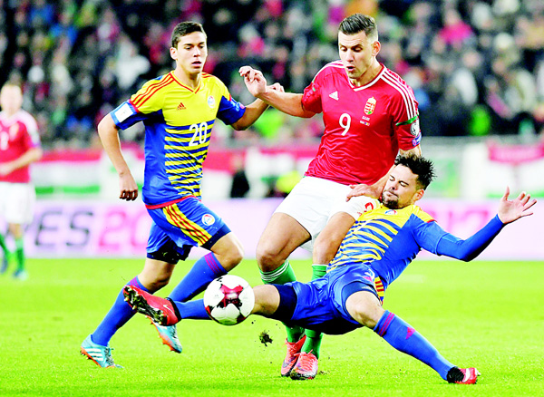 Adam Szalai of Hungary (center), and Max Llovera (left), vie for the ball with Marc Vales of Andorra, during the World Cup 2018 qualification soccer match between Hungary and Andorra in Groupama Arena in Budapest, Hungary on Nov 13. (AP)