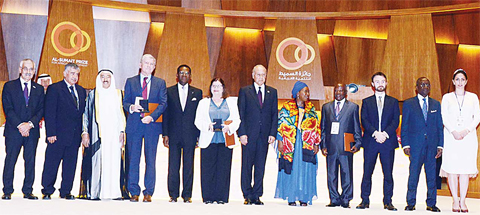 HH the Amir Sheikh Sabah Al-Ahmad Al-Jaber Al-Sabah poses with winners of Al Sumait Prize for Africa Development at a ceremony in Malabo, Equatorial Guinea