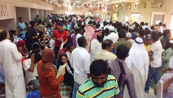 Domestic workers seen in hundreds in the Immigration Office hall.
