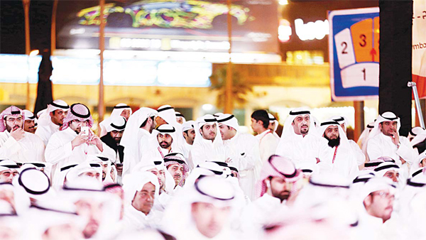 Kuwaitis attend a campaign meeting for Islamist candidate and former MP Mohammed Al-Mutairi in Kuwait City on Nov 20. (AFP)