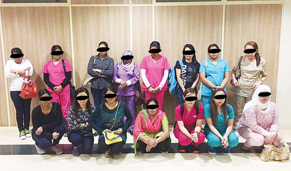 Some of the illegal domestic workers arrested at the dummy maids recruiting offices