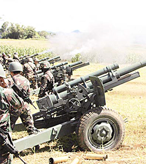 Philippine troops fire their 105mm howitzer cannons towards enemy positions from their base near Butig town in Lanao del Sur province on the southern island of Mindanao on Nov 27. (AFP)