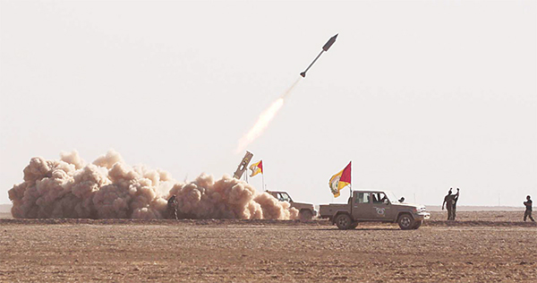 Iraqi Shiite fighters from the Hashed al-Shaabi (Popular Mobilisation) paramilitaries fire a rocket during an advance in a desert area near the village of Tall Abtah, southwest of Mosul, on Nov 28 during a broad offensive by Iraq forces to retake Mosul from jihadists of the Islamic State group