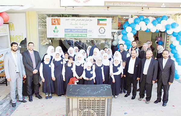 Syrian refugees attend the Kuwaiti charity's opening of the school in Turkey