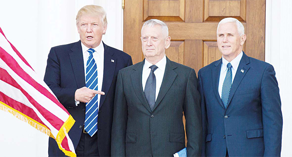 This file photo taken on Nov 19 shows US Presidentelect Donald Trump with US Marines General (retd) James Mattis and Vice-President-elect Mike Pence (right), on the steps of the clubhouse at Trump National Golf Club in Bedminster, New Jersey.