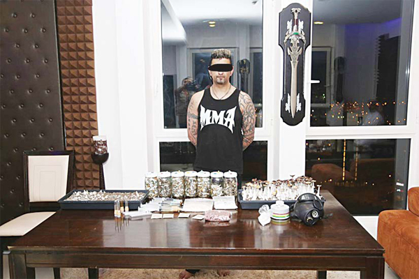 The alleged drug trafficker and contraband seized