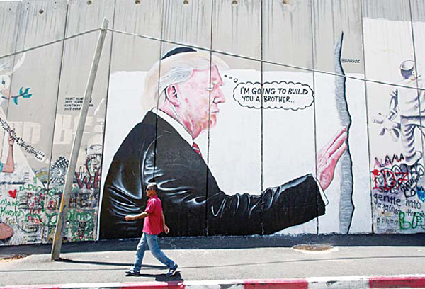 Huge Trump Murals Appear On W Bank Barrier Un Chief To