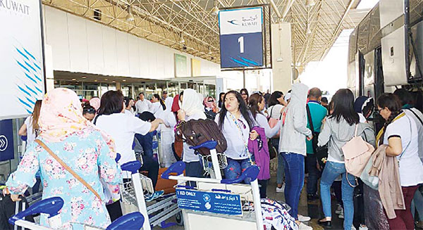 FILIPINOS TO FLY OUT FREE - Thousand register to avail Kuwait
