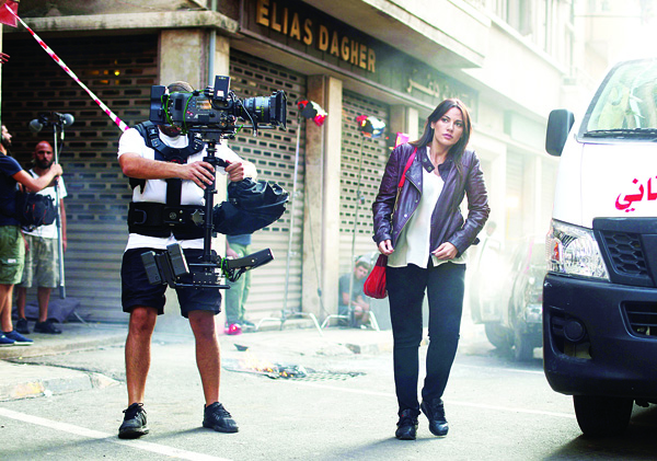 Lebanese actress Darine Hamze is seen on the set of a new movie titled 'Nuts' in Beirut on Oct 10. Nuts is a Lebanese movie produced by Lebanese producer Tarek Sikias. (AFP)