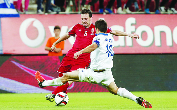 Hungary's Akos Elek (left), is challenged by Greece's Sokratis Papastathopoulos during the Group F Euro 2016 qualifying match between Greece and Hungary at the Georgios Karaiskakis Stadium in Piraeus post, near Athens on Oct 11. (AP)