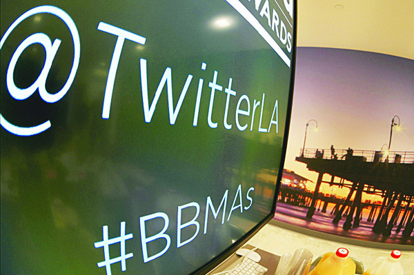This April 7, 2015 file photo shows a monitor pictured in a kitchen area at tech company Twitter's office space in Santa Monica, California. Twitter made it easier on Oct 6 to seize hot tweets and high-profile posts from the flood of real-time commentary at the one-to-many messaging service. A new 'Moments' feature that promised to let people quickly tune into 'the best of Twitter' made its debut in the United States with a promise it would spread wider in the coming months. (AFP)
