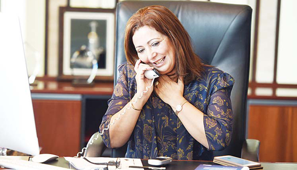 President of the Tunisian employers union (UTICA) Wided Bouchamaoui, speaks on the phone in her office in Tunis on Oct 9, after she was awarded the 2015 Nobel Peace Prize with other members of Tunisian National Dialogue Quartet. (AFP)