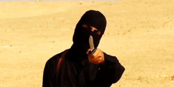 A file image grab purportedly shows a masked militant holding a knife and gesturing as he speaks to the camera in a desert landscape before beheading US freelance writer Steven Sotloff. (AFP)
