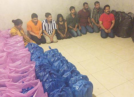 The gang of bootleggers and liquor-manufacturing material seized.