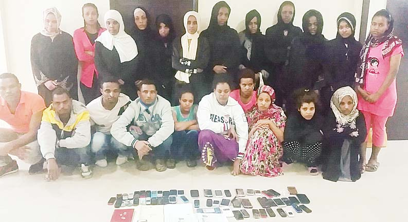 Some of the 22 'runaway' domestic workers with the gang leaders.