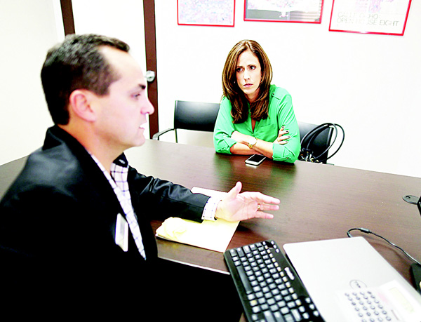 In this file photo, Natalia Mendez goes over mortgage terms with Raul J. Alvarez, Senior Loan Officer for Paramount Residential Mortgage Group, as she hopes to get a mortgage before rates possibly go up as the Federal Reserve announced that it will raise interest rates, in Miami, Florida. (AFP)