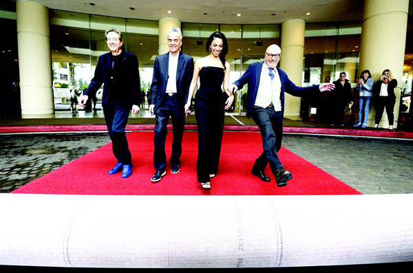 From left: Barry Adelman, executive vice-president of television for Dick Clark productions, Allen Shapiro, CEO of Dick Clark productions and Executive Producer Corinne Foxx, Miss Golden Globe 2016, and  Lorenzo Soria, Hollywood Foreign Press Association president, roll out the red carpet during the 73rd Annual Golden Globe Awards preview day at The Beverly Hilton Hotel on Jan 7, in Beverly Hills, Calif. (AFP)