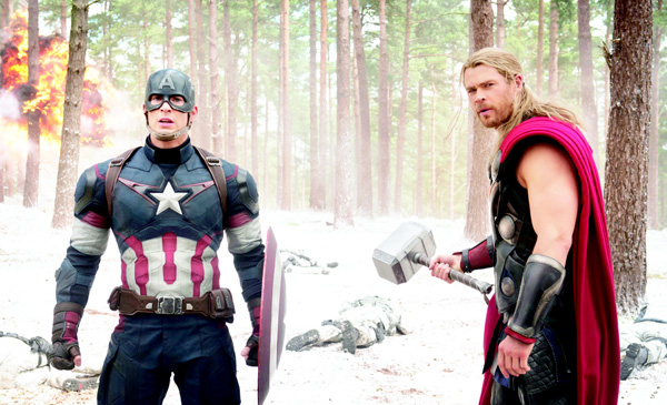 This photo provided by Disney/Marvel shows, Chris Evans (left), as Captain America/Steve Rogers, and Chris Hemsworth as Thor, in a scene of the new film, 'Avengers: Age of Ultron.' The movie released in the US on May 1, 2015. (AP)