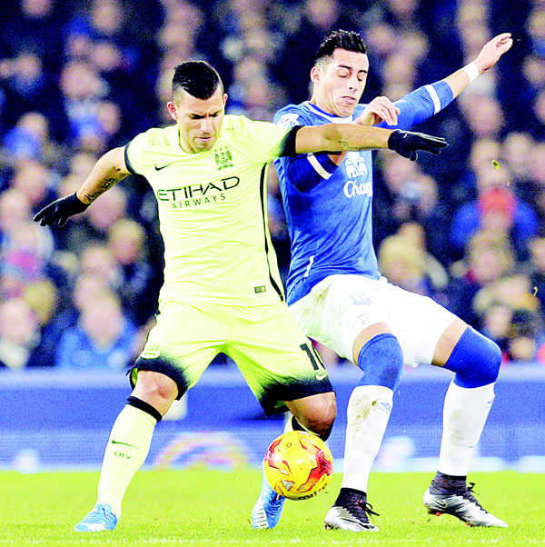 Manchester City's Argentinian striker Sergio Aguero (left), battles with Everton's Argentinian defender Ramiro Funes Mori (right), during the English League Cup semifinal first leg football match between Everton and Manchester City at Goodison Park in Liverpool, north west England on Jan 6. (AFP)