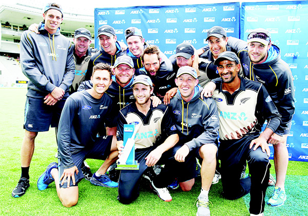 New Zealand celebrate winning the series after the second T20 cricket match between New Zealand and Sri Lanka at Eden Park in Auckland on Jan 10. (AFP)