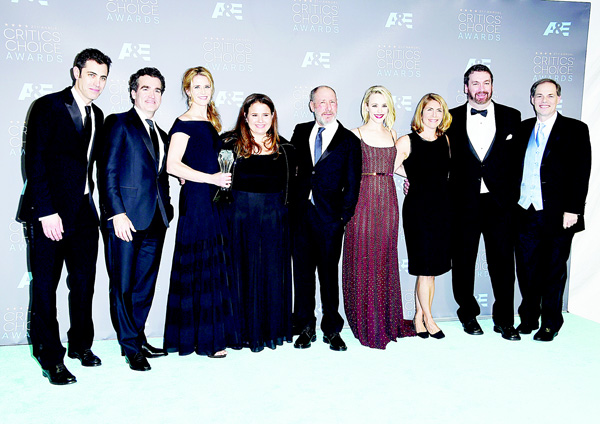 The cast and crew of 'Spotlight', Josh Singer (from left), Brian d'Arcy James, Blye Pagon Faust, Nicole Rocklin, Steve Golin, Rachel McAdams, Sacha Pfeiffer and (far right), Tom Ortenberg, pose in the press room with the award for best picture at the 21st annual Critics' Choice Awards at the Barker Hangar on Jan 17, in Santa Monica, Calif. (AP)