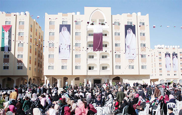 Palestinians gather at the Qatari-funded Hamad City housing complex in Khan Younis, southern Gaza Strip