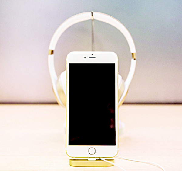 An iPhone sits on display inside the Apple store on Fifth Avenue on Jan 26, in New York City. (AFP)