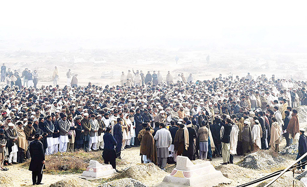 Pakistanis gather for funeral prayers for victims of the Jan 20 Bacha Khan University attack in Charsadda on Jan 21. (AFP)