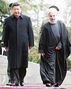 Chinese President Xi Jinping (left), is welcomed by Iranian President Hassan Rouhani. (AP)