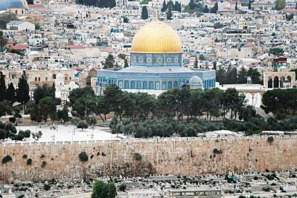 A partial view of Jerusalem's Old City's Al-Aqsa Mosque compound (with the Dome of the Rock) is seen before a rain storm on Oct 25, 2015. Israeli Prime Minister Benjamin Netanyahu said that an agreement to put 24-hour security cameras around Jerusalem's sensitive Al-Aqsa Mosque compound was in Israel's interest. Tensions raised over clashes at the mosque compound, known as Temple Mount to Jews, have spiralled into a wave of daily knife attacks and shootings on Israelis as well as deadly protests. (AFP)